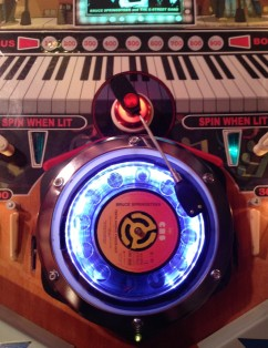The turntable lit up over the original roulette wheel